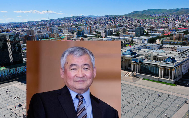 Photo: Dr Jargalsaikhan Enkhsaikhan (Credit: Global Peace Foundation) against the backdrop of Chinggis Khaan (Sükhbaatar) Square in Ulaanbaatar, the capital and largest city of Mongolia. CC BY-SA 4.0