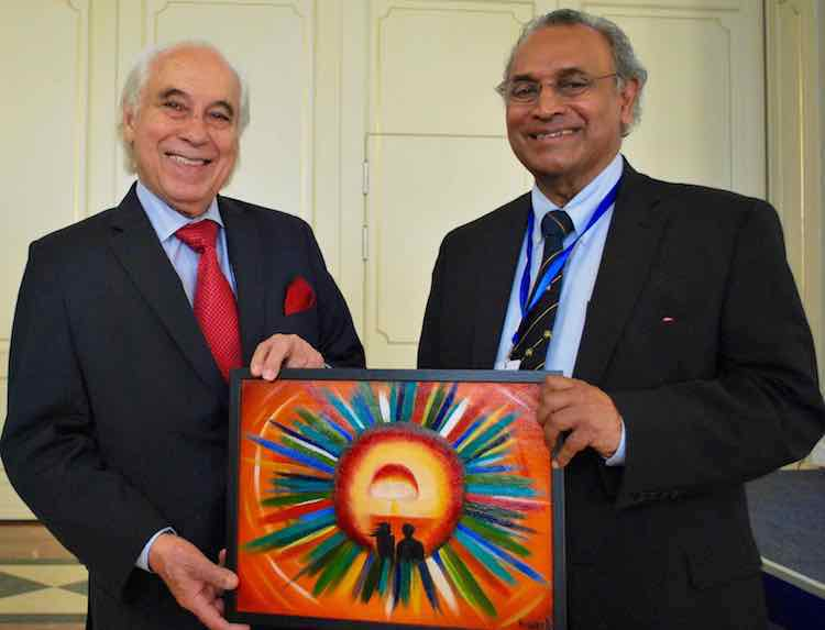 Photo: Sergio Duarte, incoming President of Pugwash and his predecessor Jayantha Dhanapala, who headed the organisation for ten years, with a painting by Kazakh artist and anti-nuclear activist Karipbek Kuyukov in Astana end of August 2017. Credit: Pugwash