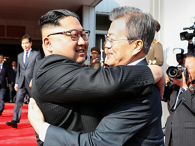 Photo: North Korean leader Kim Jong Un (left) and South Korean President Moon Jae-in embrace Saturday (May 26, 2018) on the North Korean side of the shared inter-Korean area of Panmunjom. Credit: South Korean Presidential Blue House / Getty Images