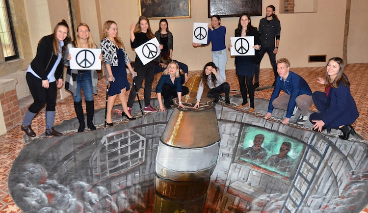 Photo: Participants in the conference 'prevent' a nuclear missile from being launched from Charles University in Prague. Credit: UNFOLD ZERO