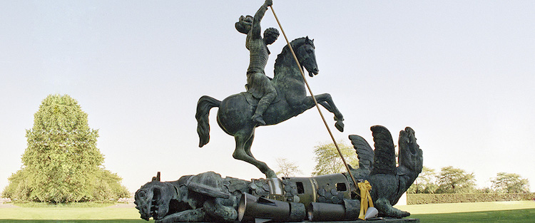 Photo: Sculpture depicting St. George slaying the dragon. The dragon is created from fragments of Soviet SS-20 and United States Pershing nuclear missiles. UN Photo/Milton Grant
